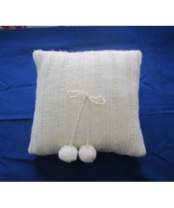 HAND KNITTED PILLOW WITH POMPONS